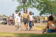 Asian family enjoying the festivities on Thomas beach at Lake Calhoun. Aquatennial Beach Bash Minneapolis Minnesota USA