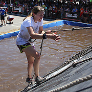 Competitors in action at the slippery Wall obstacle during the Reebok Spartan Race. Mohegan Sun, Uncasville, Connecticut, USA. 28th June 2014. Photo Tim Clayton