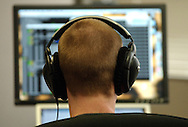 """OAKLAND - APRIL 27, 2005: Eric Bieschke, software engineer at Savage Beast Technologies, works on software for the """"music genome"""" program. Savage Beast Technologies, an Oakland startup that is creating a """"music genome"""" to identify and catalogue the instrumental, vocal, lyrical, and compositional attributes of songs, is emblematic of a new generation of post-bubble California startups. (Photo by Jakub Mosur/Getty Images for Boston Globe)"""
