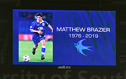 Tributes paid to former Cardiff City player Matthew Brazier prior to kick-off during the Premier League match at the Cardiff City Stadium.
