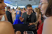 Teacher Mary Kenzer visits with students as Fairdale High School holds it's prom at the Muhammad Ali Center on Saturday, May 18.
