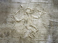 Cast of a prehistoric Petroglyph, rock carving, of a warrior dancing with a sword and shiled carved by the Camunni people in the iron age between 1000-1600 BC , Foppi di Nadro rock 24, Seradina-Bedolina Archaeological Park Museum, Valle Comenica, Lombardy, Italy .<br /> <br /> Visit our PREHISTORY PHOTO COLLECTIONS for more   photos  to download or buy as prints https://funkystock.photoshelter.com/gallery-collection/Prehistoric-Neolithic-Sites-Art-Artefacts-Pictures-Photos/C0000tfxw63zrUT4<br /> If you prefer to buy from our ALAMY PHOTO LIBRARY  Collection visit : https://www.alamy.com/portfolio/paul-williams-funkystock/valcamonica-rock-art.html