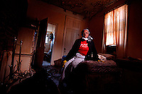 """""""Oh my God, where do I go from here? My home is destroyed, I'm out of a job...I could just cry...I feel like I need to keep my pride. I got to strive to go on."""" ..New Orleans resident Earline Melton's home was destryoed not by high floodwaters, but damage and leaks from her roof.  (Robert Caplin/New York Times)."""