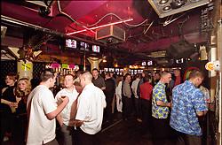 Men drinking in busy bar Newcastle UK