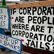 Signs at the Occupy Tampa grounds during the Republican National Convention in Tampa, Fla. on Wednesday, August 29, 2012. (AP Photo/Alex Menendez)