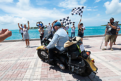 Kansan Terry Richardson riding his 1946 Harley-Davidson FL Knucklehead over the finish line during the Cross Country Chase motorcycle endurance run from Sault Sainte Marie, MI to Key West, FL. (for vintage bikes from 1930-1948). The Grand Finish in Key West's Mallory Square after the 110 mile Stage-10 ride from Miami to Key West, FL and after covering 2,368 miles of the Cross Country Chase. Sunday, September 15, 2019. Photography ©2019 Michael Lichter.