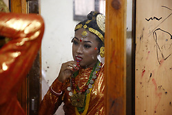 June 25, 2017 - Kathmandu, Nepal - A Nepalese transgender dressed in traditional attire looks at a mirror getting ready before a cultural dance program in Kathmandu, Nepal on Sunday, June 25, 2017. (Credit Image: © Skanda Gautam via ZUMA Wire)
