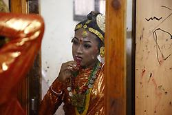 June 25, 2017 - Kathmandu, Nepal - A Nepalese transgender dressed in traditional attire looks at a mirror getting ready before a cultural dance program in Kathmandu, Nepal on Sunday, June 25, 2017. (Credit Image: © Skanda Gautam via ZUMA Wire)
