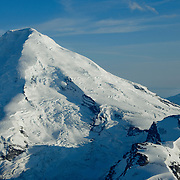 Iliamna Volcano towers above the Chigmit Mountains in Clark National Park, Alaska