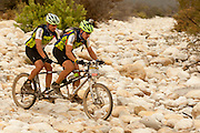 Gerrie Olivier and the blind Hein Wagner cycel their tandem through a dry river bed consisting of large roubd boulders during stage 3 of the 2011 Absa Cape Epic Mountain Bike stage race held from Saronsberg Wine Estate in Tulbagh to Worcester Gymnasium in Worcester, South Africa on the 30 March 2011..Photo by Greg Beadle/Cape Epic/SPORTZPICS