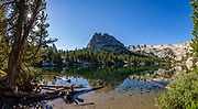 Crystal Crag and Mammoth Crest reflect in Crystal Lake in Inyo National Forest, Mammoth Lakes village, USA. Hike from Lake George to Crystal Lake (side trip) and Mammoth Crest (7 miles with 2000 ft gain). Multiple overlapping photos were stitched to make this panorama.