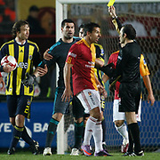 Referee's Cuneyt CAKIR show the yellow card to Galatasaray's Milan BAROS during their Turkish superleague soccer derby match Galatasaray between Fenerbahce at the AliSamiYen Stadium at Mecidiyekoy in Istanbul Turkey on Sunday, 28 March 2010. Photo by Aykut AKICI/TURKPIX
