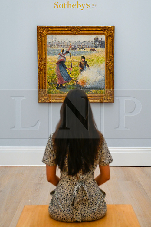 © Licensed to London News Pictures. 29/01/2020. LONDON, UK. A staff member views ''Gelée Blanche, Jeune Paysanne Faisant Du Feu'' by Camille Pissarro, (Est. £8,000,000 - 12,000,000). Preview of Sotheby's Impressionist & Modern and Surrealist Art sales.  The auction will take place at Sotheby's New Bond Street on 4 and 5 February 2020.  Photo credit: Stephen Chung/LNP