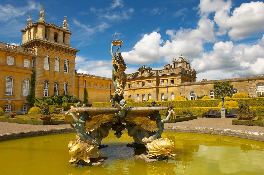 Pictures images photos of Blenheim Palace Italian garden and fountain, Woodstock, Oxfordshire, England. At the centre of the formal Italian garden of Blenheim Palace is the Mermaid fountain, the work of Thomas Waldo Storey (1855-1915). Blenheim Palace is a country house in Woodstock, Oxfordshire, England. It is the seat of the Dukes of Marlborough and the only non-royal, non-episcopal country house in England to hold the title of palace. The palace, one of England's largest houses, was built between 1705 and 1722, and designated a UNESCO World Heritage Site in 1987 .<br /> <br /> Visit our EARLY MODERN ERA HISTORICAL PLACES PHOTO COLLECTIONS for more photos to buy as wall art prints https://funkystock.photoshelter.com/gallery-collection/Modern-Era-Historic-Places-Art-Artefact-Antiquities-Picture-Images-of/C00002pOjgcLacqI