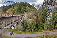Road bicycling on the Olympic Discovery Trail across the Elwah River near Port Angeles, Washington, USA MR