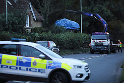 © Licensed to London News Pictures. 16/08/2020. Calne, UK. The vehicle being removed from the scene at Derry Hill near Calne in Wiltshire where four people have been killed in a road traffic accident in which a car is believed to have hit a house then caught fire.  Photo credit: Tim Ireland/LNP