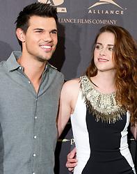 Taylor Lautner (L)  Kristen Stewart (R) attend the Twilight II photocall,  Villa Magna Hotel, Madrid, Spain, November 15, 2012.  Photo by Belen Diaz / Eduardo Dieguez / DyD FOtografos / i-Images...SPAIN OUT
