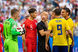 July 7, 2018 - Samara, RUSSIA - 180707 Marcus Berg and Albin Ekdal of Sweden in a discussion with goalkeeper Jordan Pickford and John Stones of England while referee Bjorn Kuipers intervenes during the FIFA World Cup quarter final match between Sweden and England on July 7, 2018 in Samara..Photo: Joel Marklund / BILDBYRÃ…N / kod JM / 87755 (Credit Image: © Joel Marklund/Bildbyran via ZUMA Press)