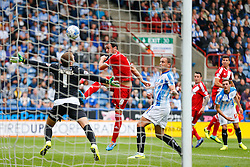 A shot from Kike of Middlesbrough goes over Alex Smithies of Huddersfield and over the bar - Photo mandatory by-line: Rogan Thomson/JMP - 07966 386802 - 13/09/2014 - SPORT - FOOTBALL - Huddersfield, England - The John Smith's Stadium - Huddersfield town v Middlesbrough - Sky Bet Championship.