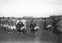 H530<br /> Tailteann Games. Variuos teams parading. Hurlers; hurling. 1924.  (Part of the Independent Newspapers Ireland/NLI Collection)
