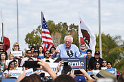 Sanders at the Podium Surrounded by Supporters at an Outdoor Rally