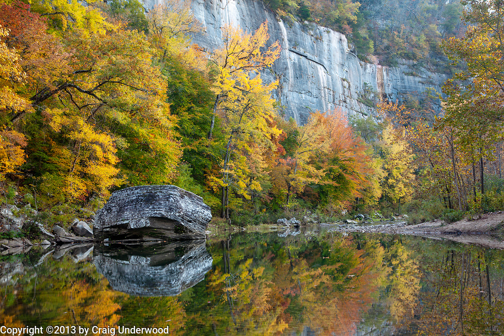 A massive boulder from the bluff above rests peacefully along the banks of the Buffalo River, just below Steel Creek.