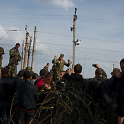 KRAMATORSK, UKRAINE - April 16, 2014: The commander of a column of Ukrainian men riding on armoured personnel carriers and tanks, blocked by pro-Russia activists in the eastern Ukrainian city of Kramatorsk, attempts to negotiate with the protestors a free passage for the convoy.