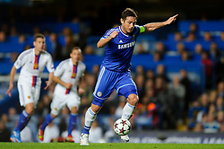 Chelsea Midfielder Frank Lampard (ENG) dribbles through the Basel defence to set up Midfielder Oscar (BRA) who goes on to score a goal during the first half of the match - Photo mandatory by-line: Rogan Thomson/JMP - Tel: 07966 386802 - 18/09/2013 - SPORT - FOOTBALL - Stamford Bridge, London - Chelsea v FC Basel - UEFA Champions League Group E