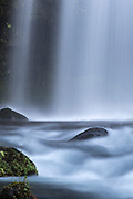Water softly flows over Twin Falls on its way to the Lower Lewis River