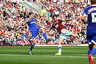 George Boyd of Burnley (r) looks to shoot under pressure from Lasse Vibe of Brentford. Skybet football league championship match, Burnley  v Brentford at Turf Moor in Burnley, Lancs on Saturday 22nd August 2015.<br /> pic by Chris Stading, Andrew Orchard sports photography.