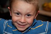 Happy adventurous impish Polish boy age 6. Zawady Central Poland