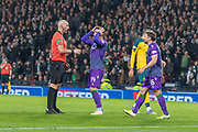 Stephen Mallan of Hibernian holds his head in his hands following the referee's decision to award a free kick on the edge of the box during the Betfred Scottish League Cup semi-final match between Hibernian and Celtic at Hampden Park, Glasgow, United Kingdom on 2 November 2019.