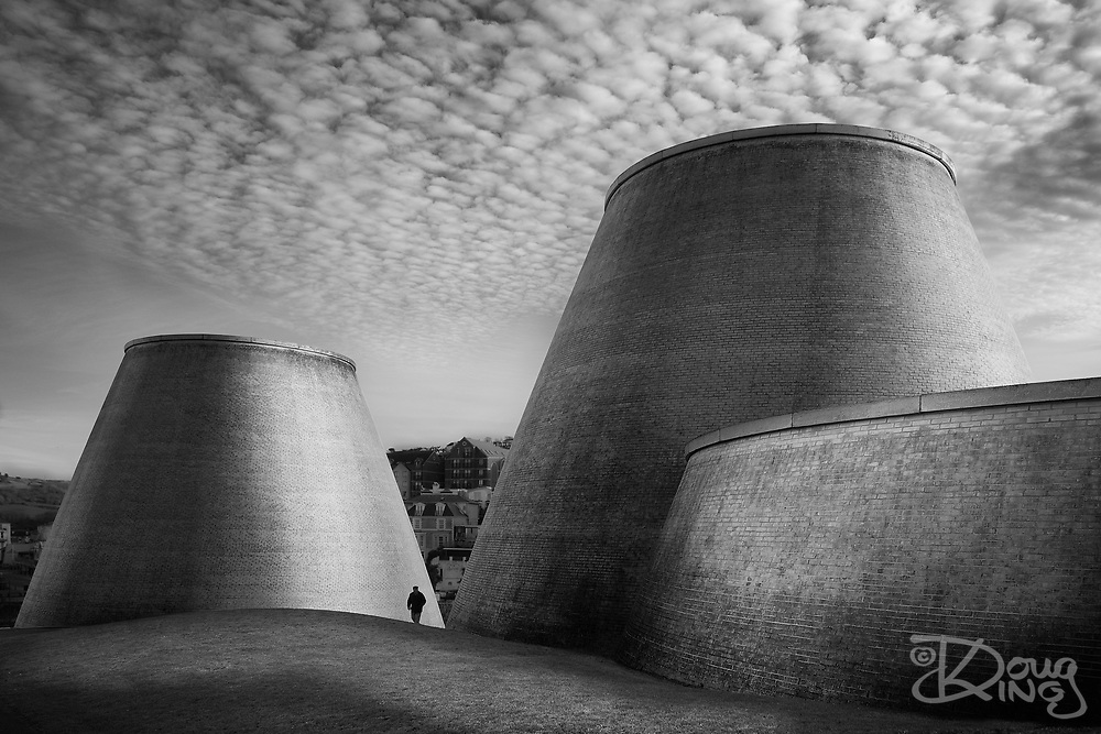 I have worked with Tim Ronalds on a number of projects, including very limited input to the design of the Landmark Theatre in Ilfracombe. On a trip to North Devon I went back to look at how the building has patinated, exposed to the Atlantic weather. The altocumulus clouds that were just forming were a gift.<br />