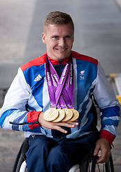 © Licensed to London News Pictures. 10/09/2012. LONDON, UK. Paralympic gold medal winning athlete David Weir holds his medals as he arrives at a reception for British Olympic and Paralymic athletes held at the Queen Elizabeth II Conference Centre in London today (10/09/12). Photo credit: Matt Cetti-Roberts/LNP