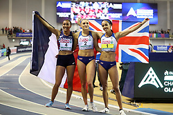 Great Britain's Katarina Johnson-Thompson (right) after finishing first in the Pentathlon Women 800m and winning gold in the overall Pentathlon event alongside second placed Niamh Emerson (centre) and third placed France's Solene Ndama during day one of the European Indoor Athletics Championships at the Emirates Arena, Glasgow.