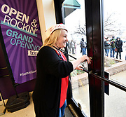 Gordman's store manager Charlene Sparks unlocks the door for shoppers at 3 pm. Shoppers looking for bargains and discounted items endured a light but steady rain on Thanksgiving Day as they waited for stores to open in Fairview Heights, IL on November 28, 2019.<br />  Photo by Tim Vizer