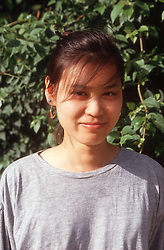 Portrait of young woman smiling,