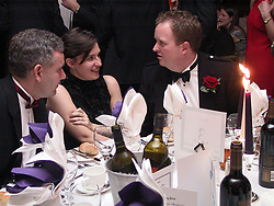 GP Booster Ball <br />Left to Right; <br />Doctors,Christopher Roberts, Paula Jones (centre) and Andrew McGinty (Right) seated for dinner<br /><br />Venue: Royal Victoria Hotel, (holiday inn), Sheffield<br />Date: Saturday 10 November