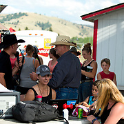 Jeff Marn and Cal Ruark discuss the preshow plans at the Darby MT Kiddie Rodeo July 7th 2017.  Photo by Josh Homer/Burning Ember Photography.  Photo credit must be given on all uses.