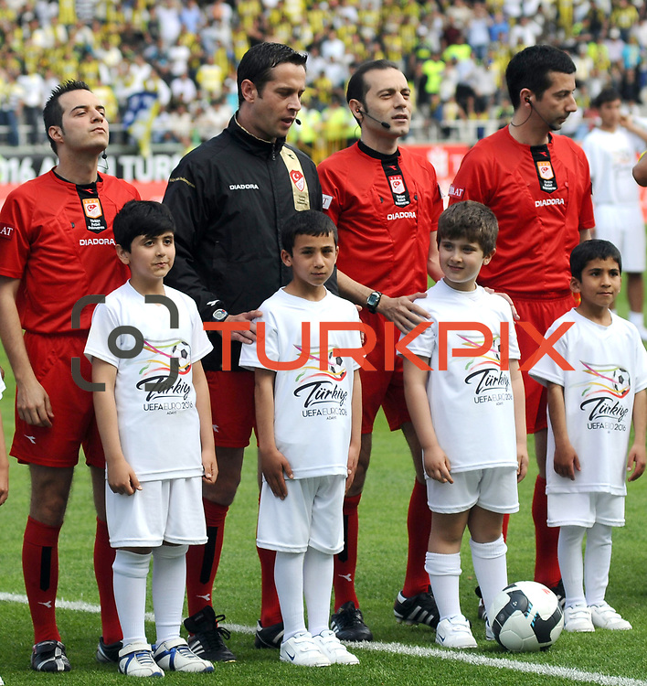 Referee's Cuneyt CAKIR (2ndR) during their Turkey Cup final match Trabzonspor between Fenerbahce at the GAP Arena Stadium at Urfa Turkey on wednesday, 05 May 2010. Photo by TURKPIX