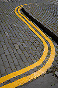 Freshly-Painted Double-Yellow Lines on Cobbled Street in Edinburgh, on 26th June 2019, in Edinburgh, Scotland.