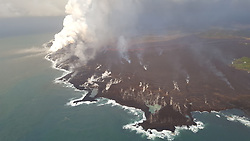 June 16, 2018 - Kapoho, Hawaii, U.S. - Lava from fissure 8 travels about 13 km (8 mi) down a well established channel (visible in the center of the image) to an ocean entry at Kapoho. Lava is building a seaward delta that is approximately 320 acres in size. The view is to the southwest with the Kapoho area in the lower right. The white plume is the vigorous ocean entry at Vacationland. (Credit Image: © USGS/ZUMA Wire/ZUMAPRESS.com)