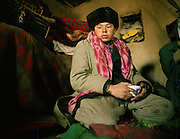A young Kyrgyz opium user from Chelab camp. Winter expedition through the Wakhan Corridor and into the Afghan Pamir mountains, to document the life of the Afghan Kyrgyz tribe. January/February 2008. Afghanistan