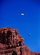 Bell 206L Helicopter sling loading a pair of outhouses from the Havasu Campground to the canyon rim, Havasupai Indian Reservation, Grand Canyon, Arizona.