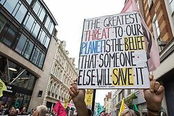 Environmental activists from Extinction Rebellion take part in the first day of Impossible Rebellion protests in the Covent Garden area on 23rd August 2021 in London, United Kingdom. Extinction Rebellion are calling on the UK government to cease all new fossil fuel investment with immediate effect. (photo by Mark Kerrison/In Pictures via Getty Images)
