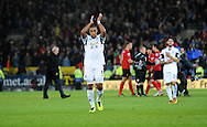 Swansea City Captain Ashley Williams claps the travelling fans at the end of the game.<br /> Barclays Premier League match, Cardiff city v Swansea city at the Cardiff city stadium in Cardiff, South Wales on Sunday 3rd Nov 2013. pic by Phil Rees, Andrew Orchard sports photography,