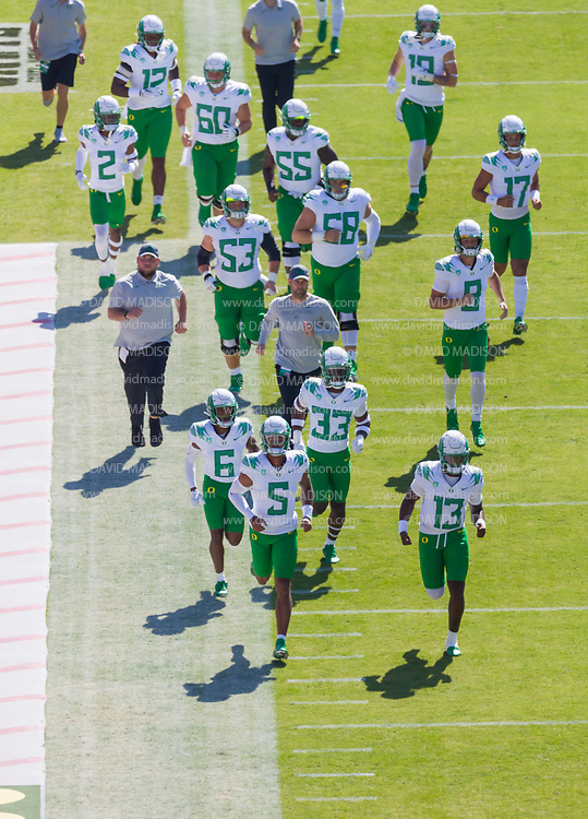 PALO ALTO, CA - OCTOBER 2:  The Oregon Duck football team warms up before before a Pac-12 football game against the Stanford Cardinal on October 2, 2021 at Stanford Stadium in Palo Alto, California.  (Photo by David Madison/Getty Images)
