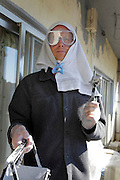 person with improvised protection during a do it yourself painting chores job