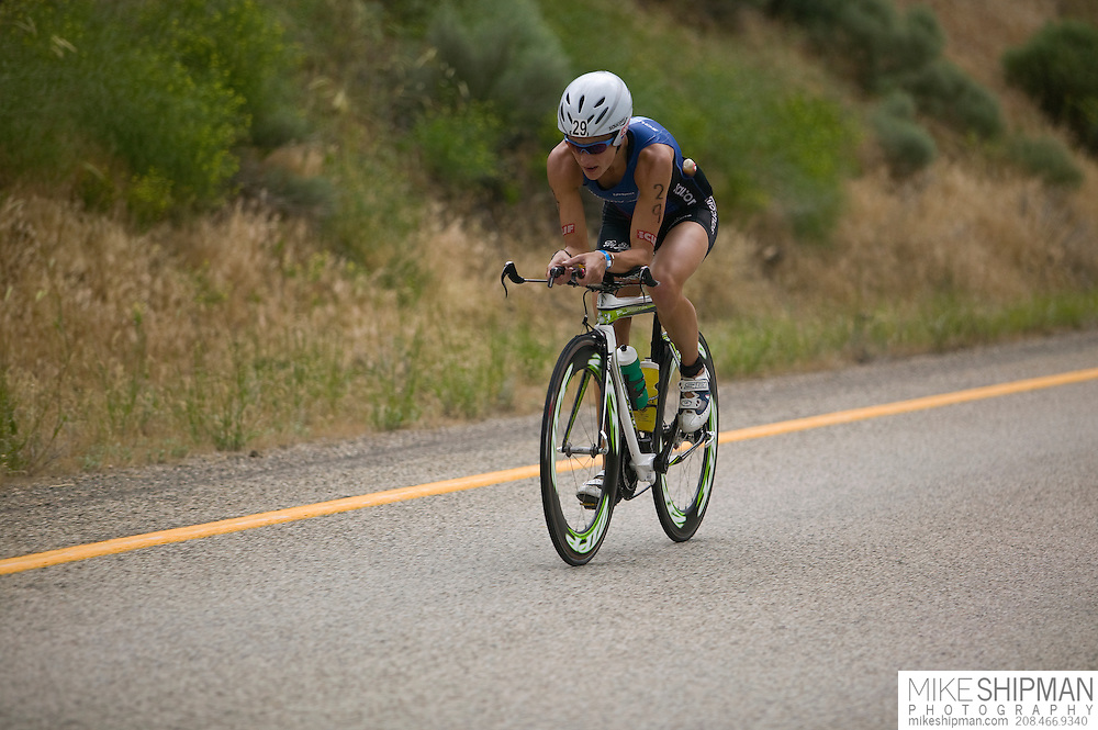 Idaho, Ada County, Boise, Boise 70.3 Ironman, Linsey Corbin from Missoula, MT, cycles away from Lucky Peak Reservoir toward Boise and the desert,  She finished second behind Magali Tisseyre with a time of 4:20:58