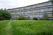 The partially derelict Robin Hood Gardens estate on 20th May 2016 in Poplar, London United Kingdom. Designed in the late 1960s by Alison and Peter Smithson, the estate was completed in 1972. Brutalist in design, it was built as council housing with streets in the sky', a style of architecture that emerged in Britain during the 60s & 70s.